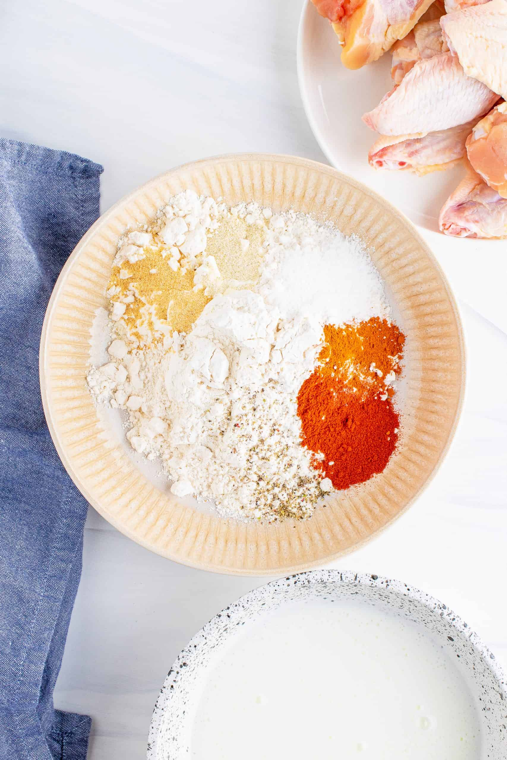 flour, paprika, cayenne pepper, salt, garlic and onion powders.