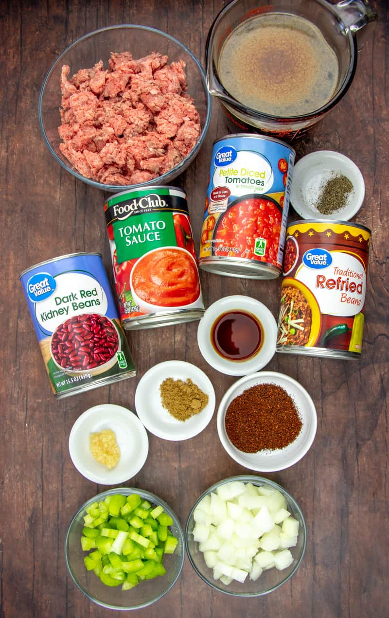 ingredients needed for chili: ground beef, celery, onion, chili powder, cumin, garlic, petite diced tomatoes, tomato sauce, dark red kidney beans, beef broth, refried beans, Worcestershire sauce, salt and pepper