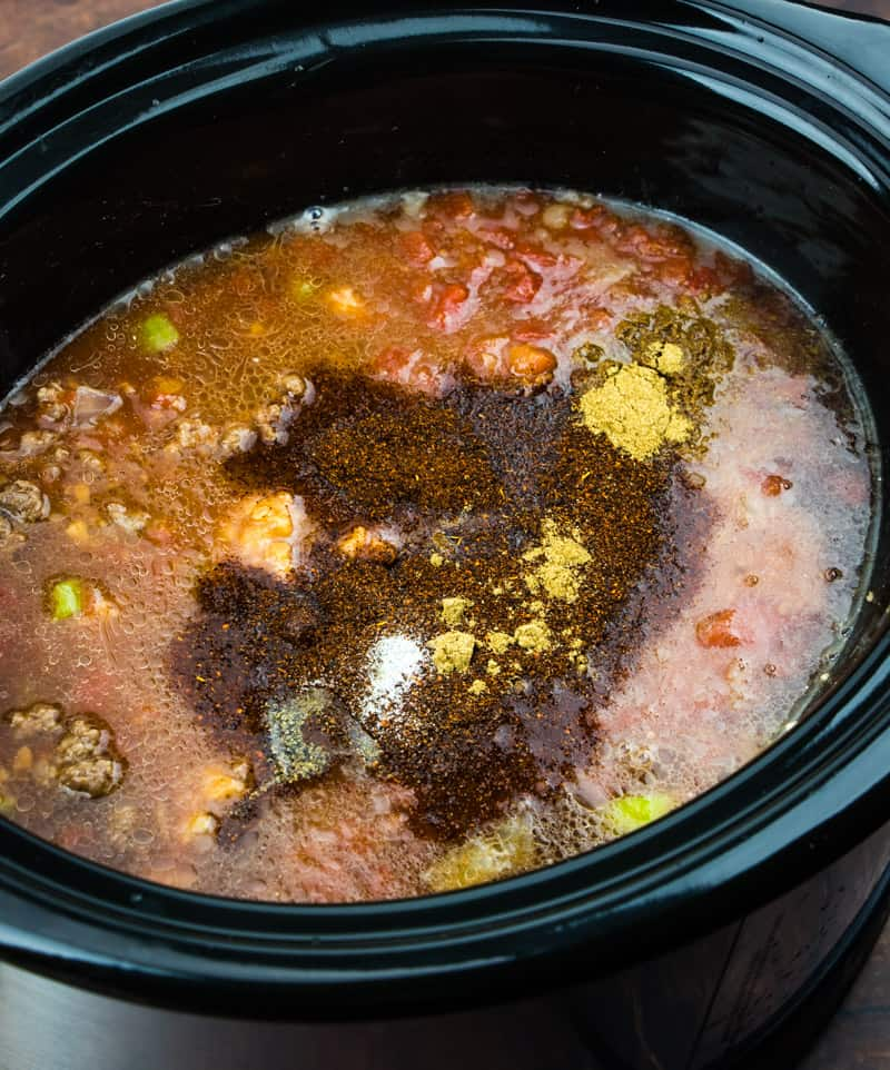 oval slow cooker with crock pot chili ingredients.