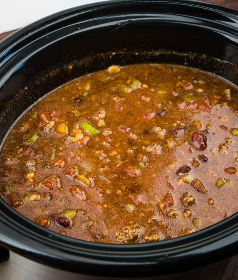 Crock pot ground beef chili cooking in 4 quart slow cooker