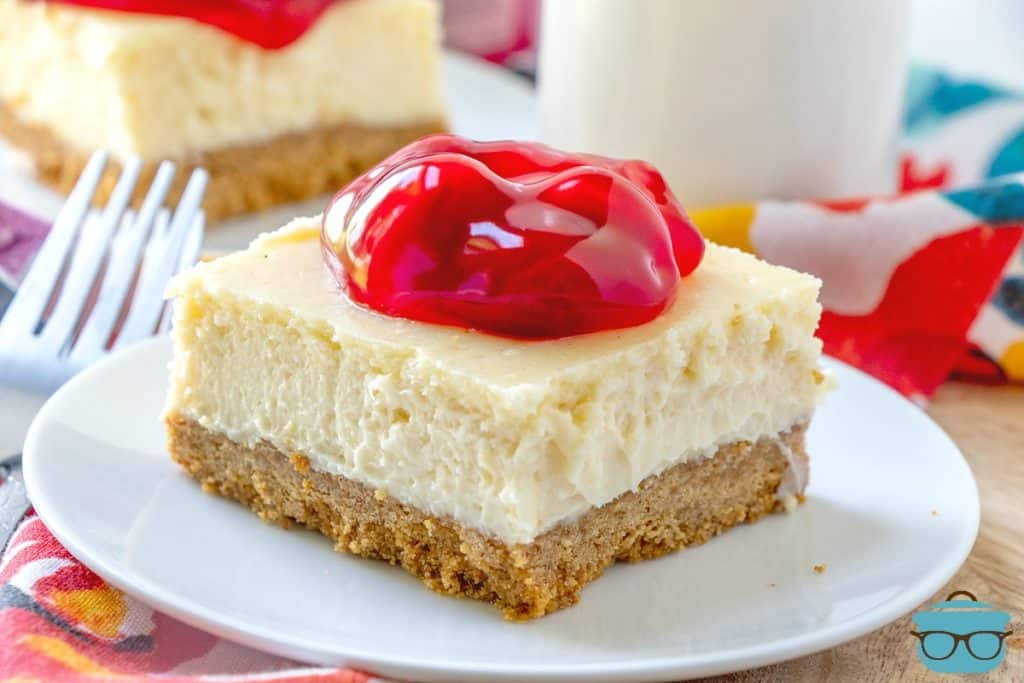Cherry Cheesecake Bar slice on a white plate