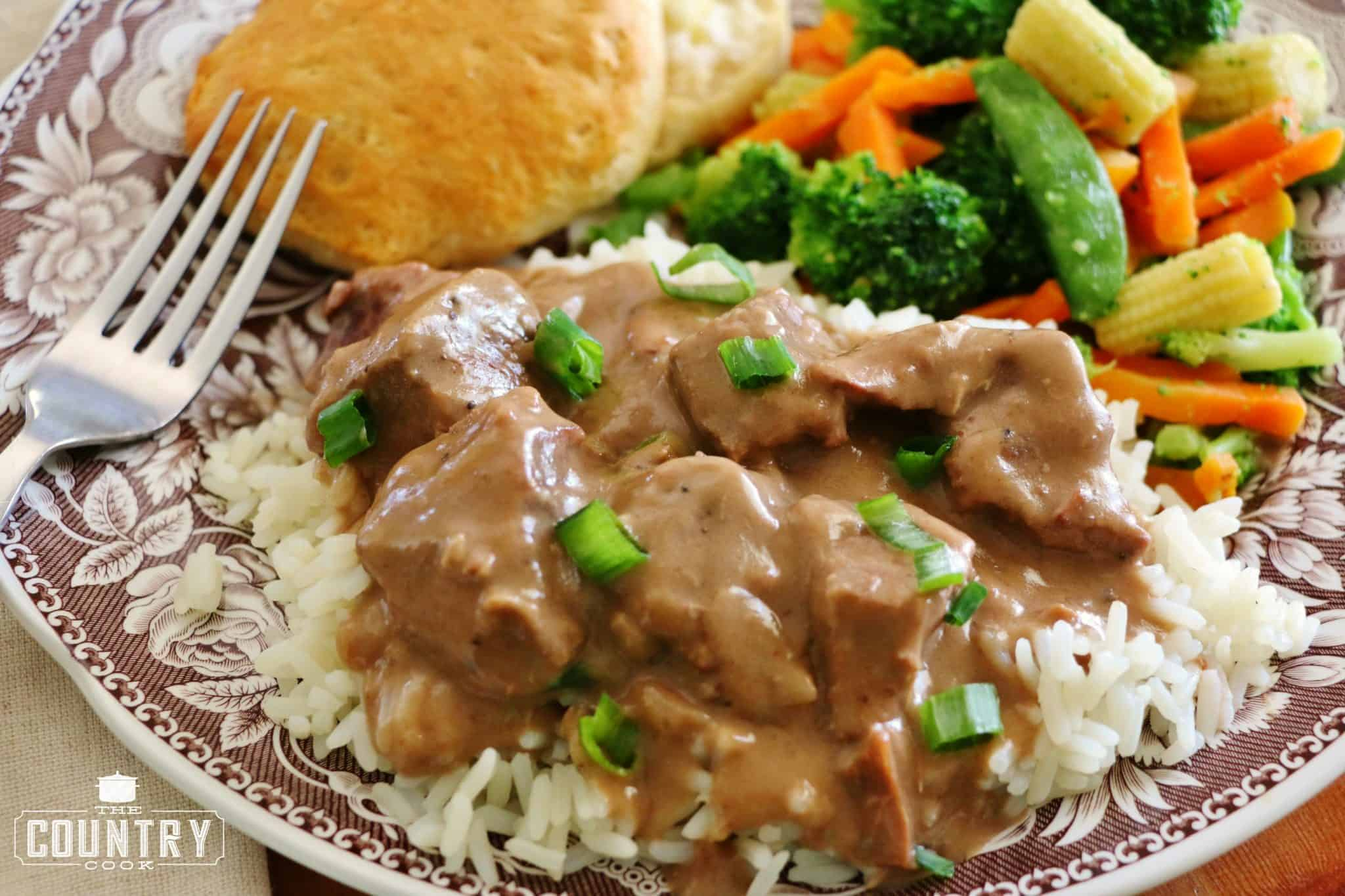 Crock Pot Beef Tips and Gravy served over cooked rice