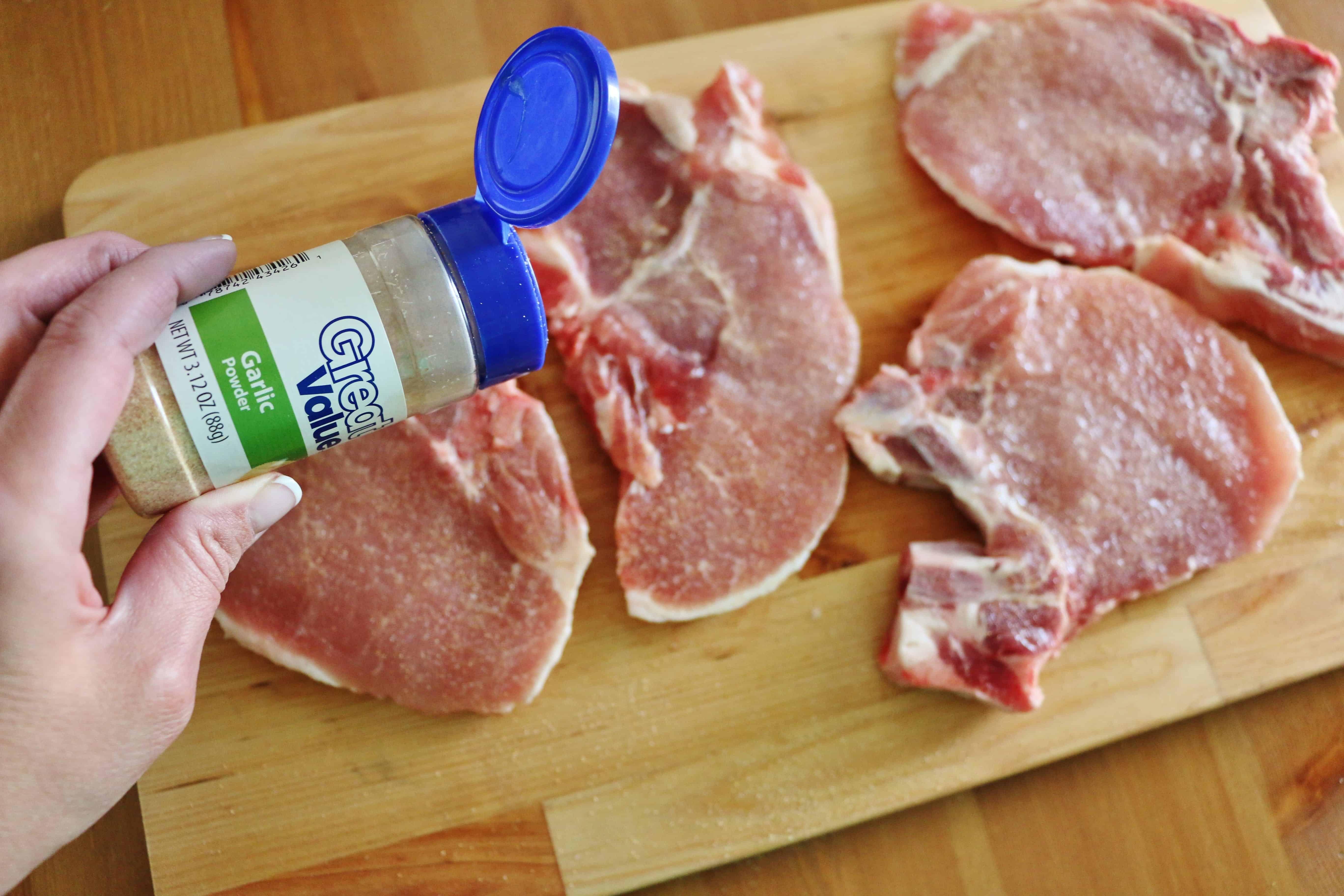 sprinkling pork chops with garlic powder.