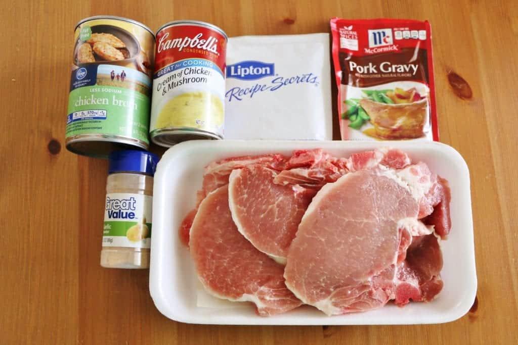 crock pot pork chops ingredients: bone-in pork chops, pork gravy mix, cream of chicken soup, garlic powder, onion soup mix
