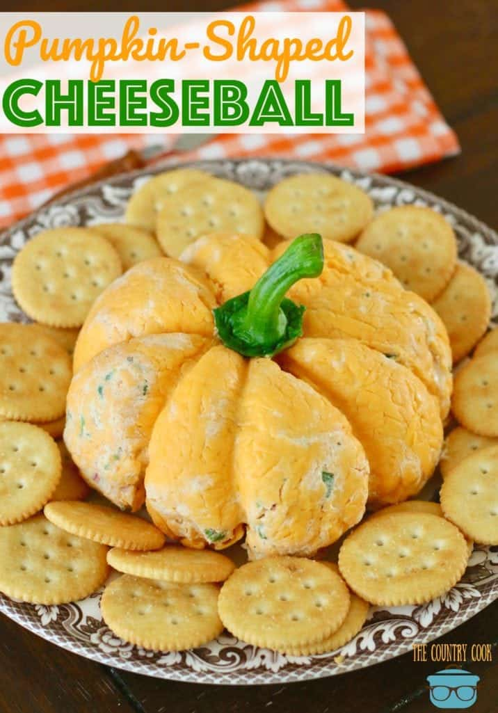Pumpkin-Shaped Cheeseball recipe from The Country Cook. Cheeseball shown on a brown and white plate with Ritz crackers surrounding the cheeseball.