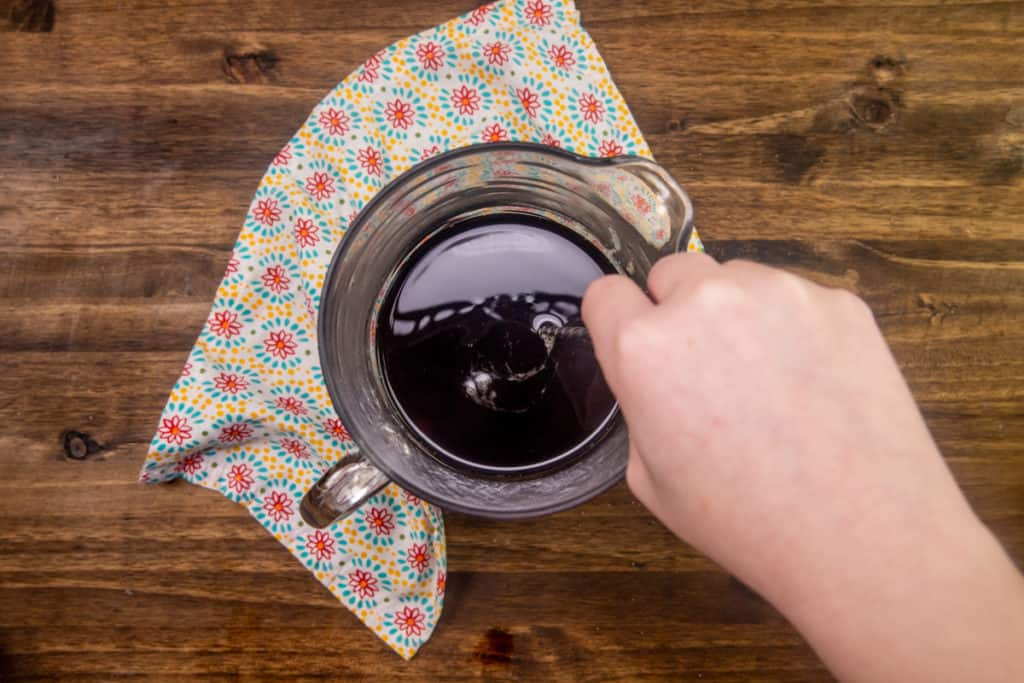 adding additional water and sugar to the gallon of brewed tea