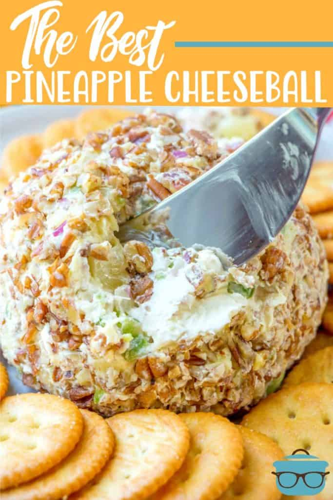 The Best Pineapple Cheeseball recipe from The Country Cook shown on a plate surrounded by buttery crackers and a serving knife