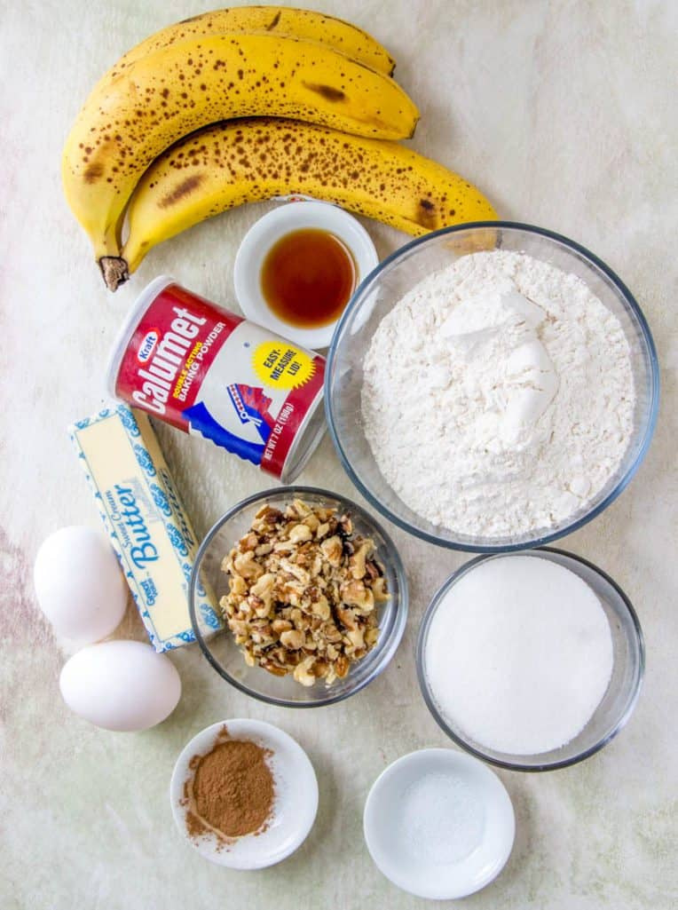 ripe bananas, flour, butter, eggs, cinnamon, vanilla extract, walnuts, baking powder