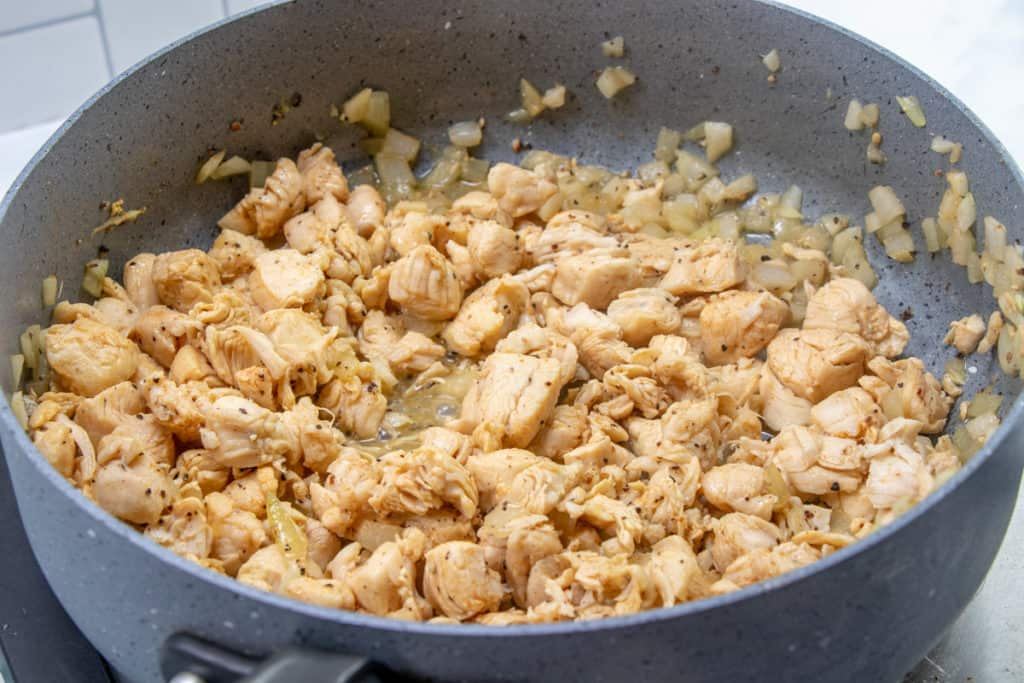 cooked, seasoned chicken breast in a large pan