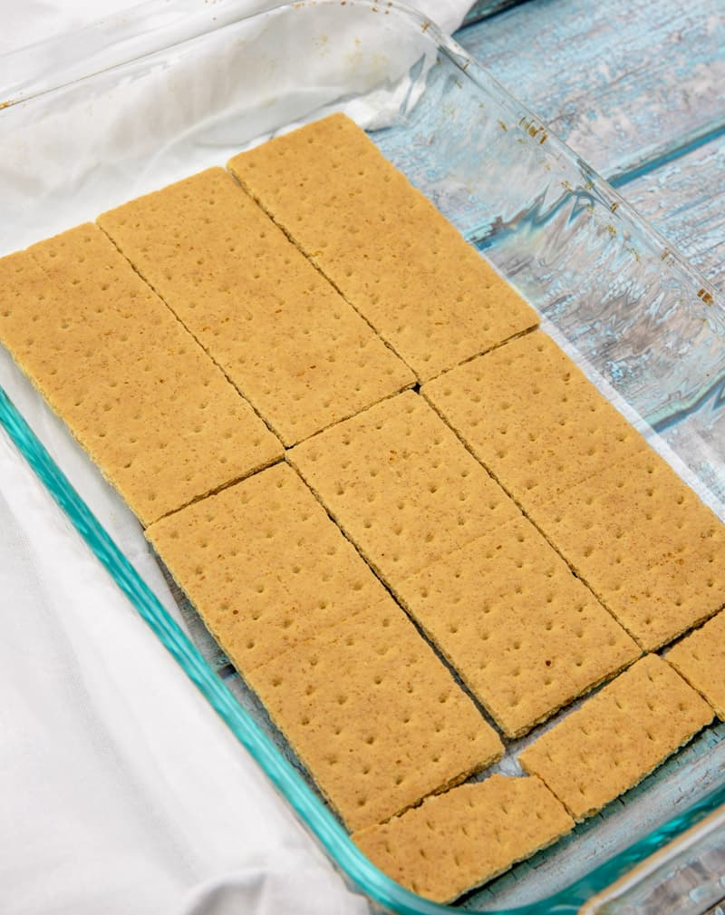 graham crackers layer into the bottom of a baking dish
