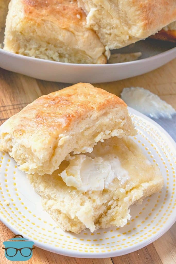 Easy Biscuit Yeast Rolls served on a plate with melted butter