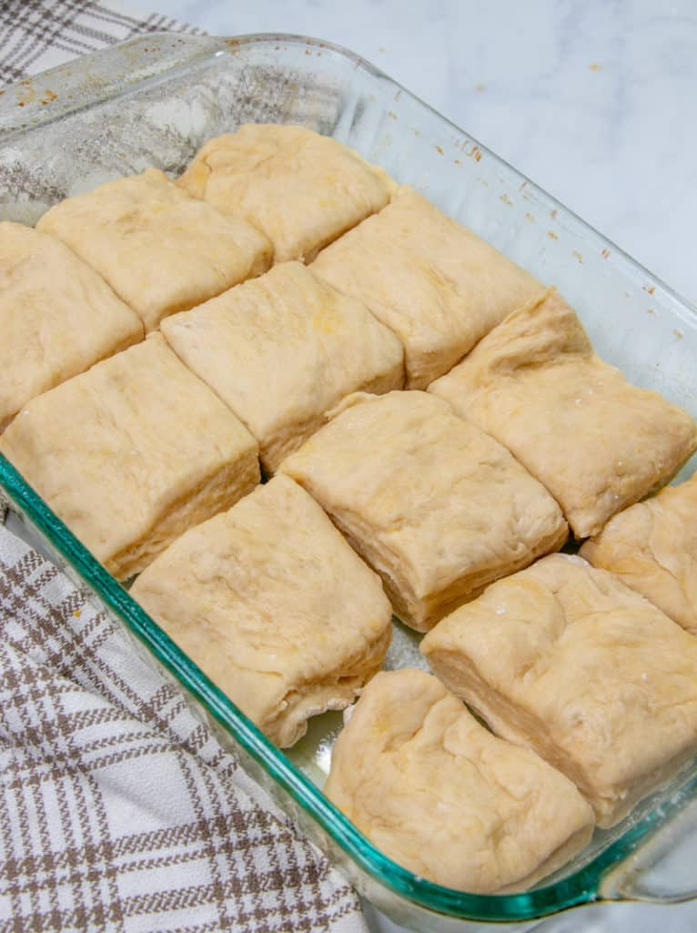 yeast rolls placed into a 9X13 glass Pyrex baking dish before rising