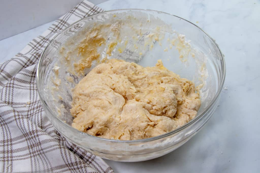 all purpose flour, yeast and melted butter added to flour mixture in a large bowl