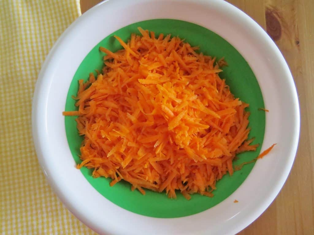 freshly shredded carrots in Pampered Chef collapsible bowl