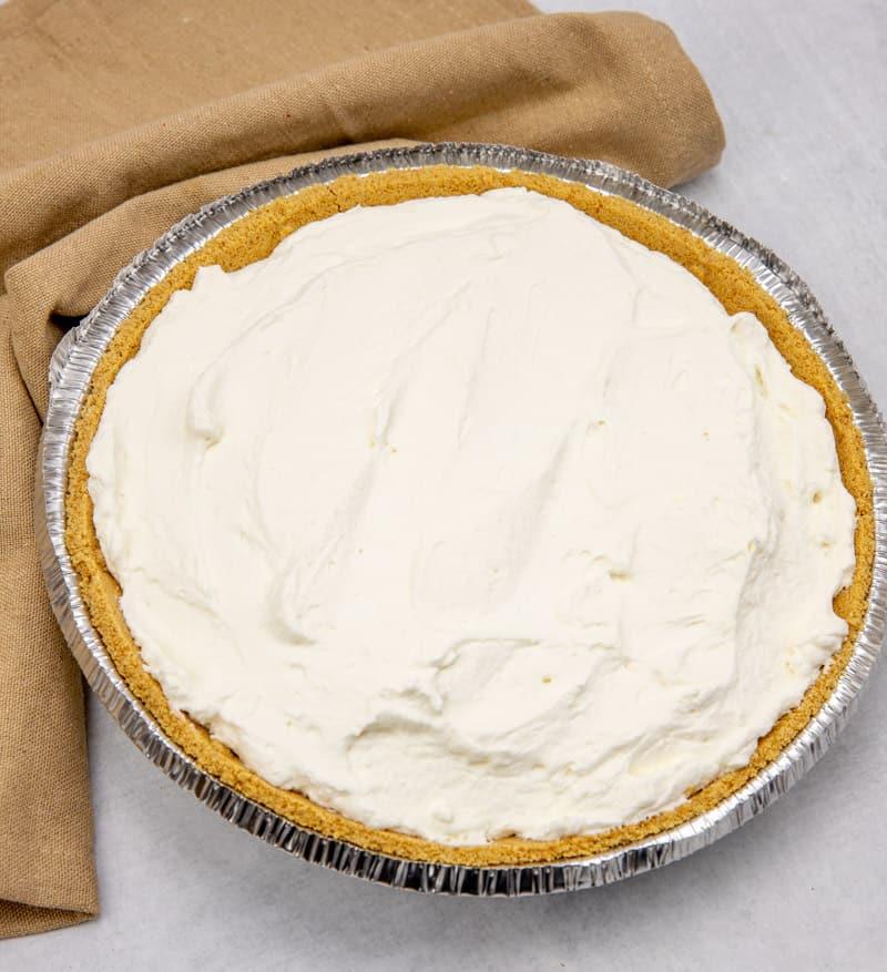 fresh whipped cream on banoffee pie.