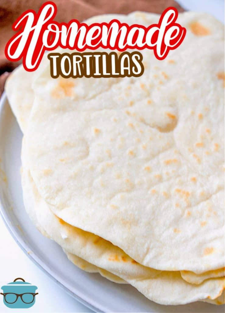 Homemade Flour Tortillas recipe from The Country Cook, flour tortillas shown stacked on a white plate