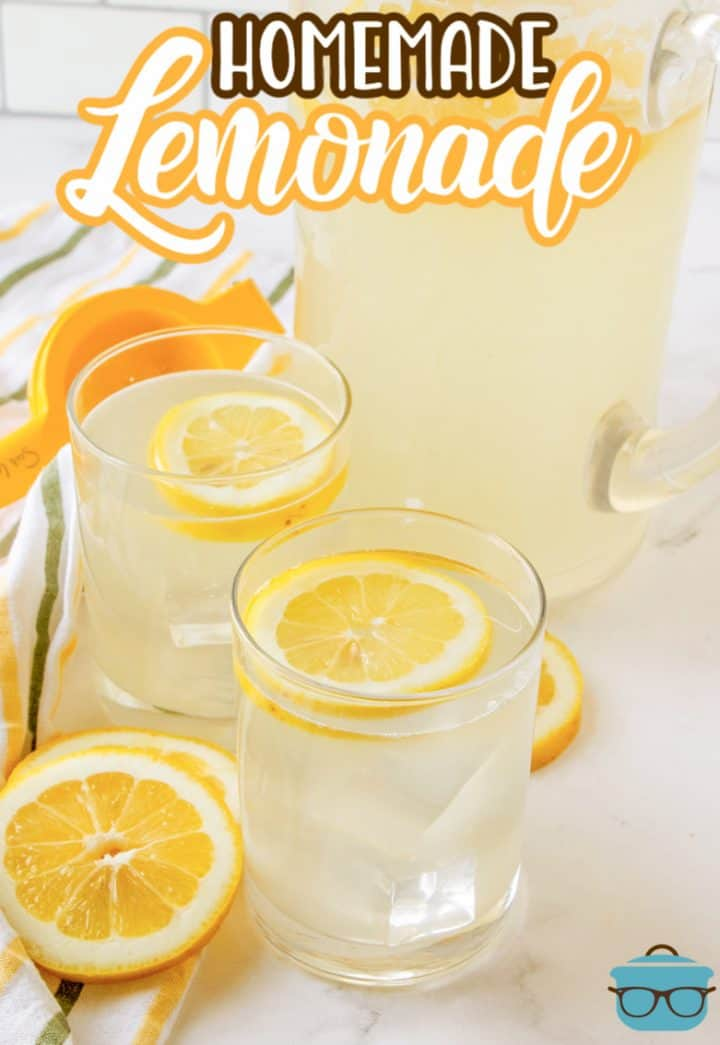 Homemade Pink Lemonade recipe photo shown with two glasses filled with lemonade and slices of lemon in them