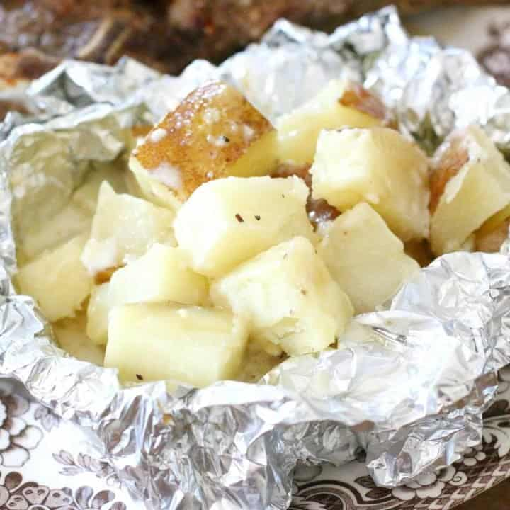 Creamy Garlic Potato Packets with grilled steak