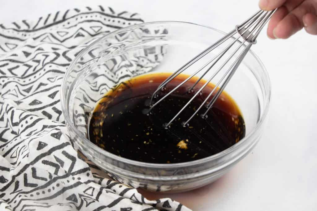 soy sauce, white wine (or chicken broth), sugar in the raw, freshly grated ginger, garlic whisked together in a bowl