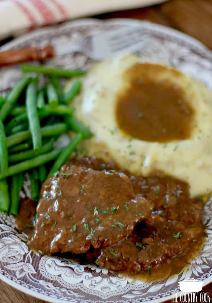 Crock Pot Cube Steak and Gravy served with mashed potatoes and green beans