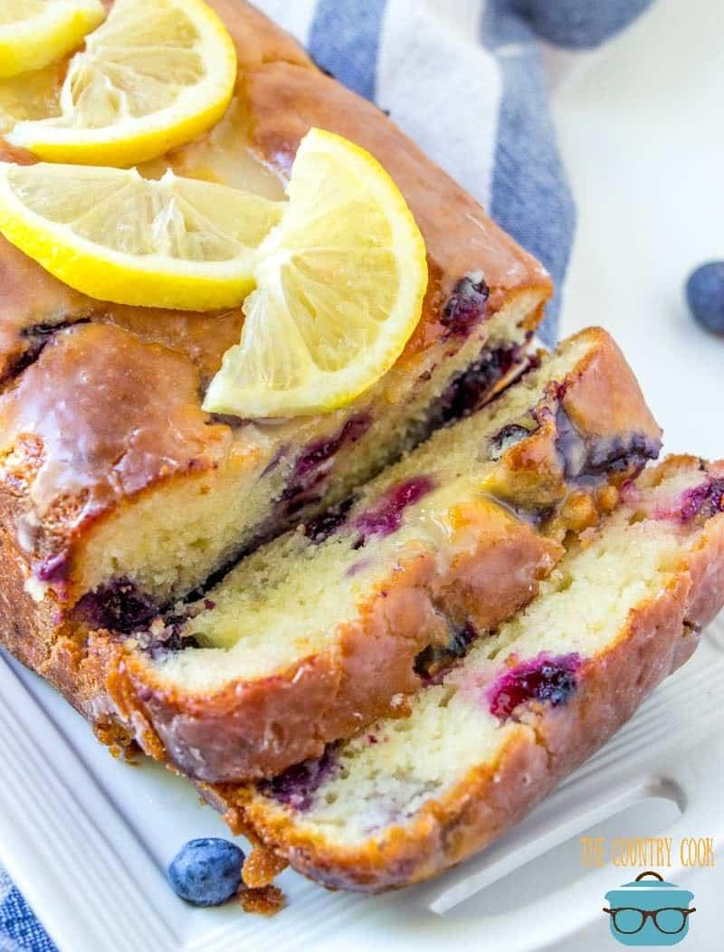 sliced Lemon Blueberry Yogurt Bread with fresh blueberries.