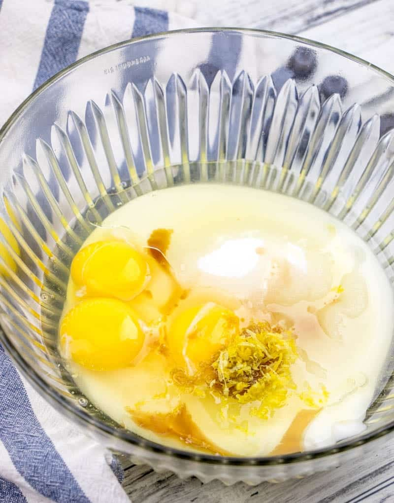 yogurt, sugar, eggs, lemon zest, vanilla extract stirred together in a bowl