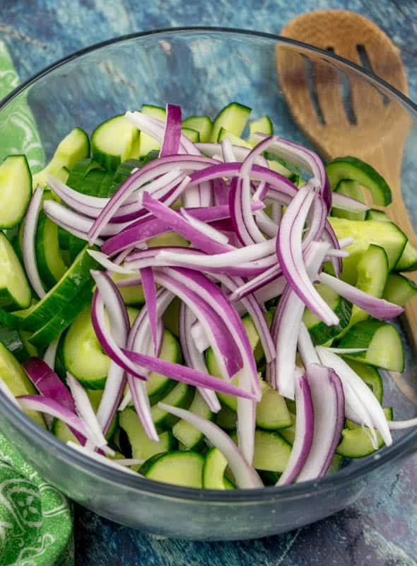 sliced cucumbers and sliced red onions
