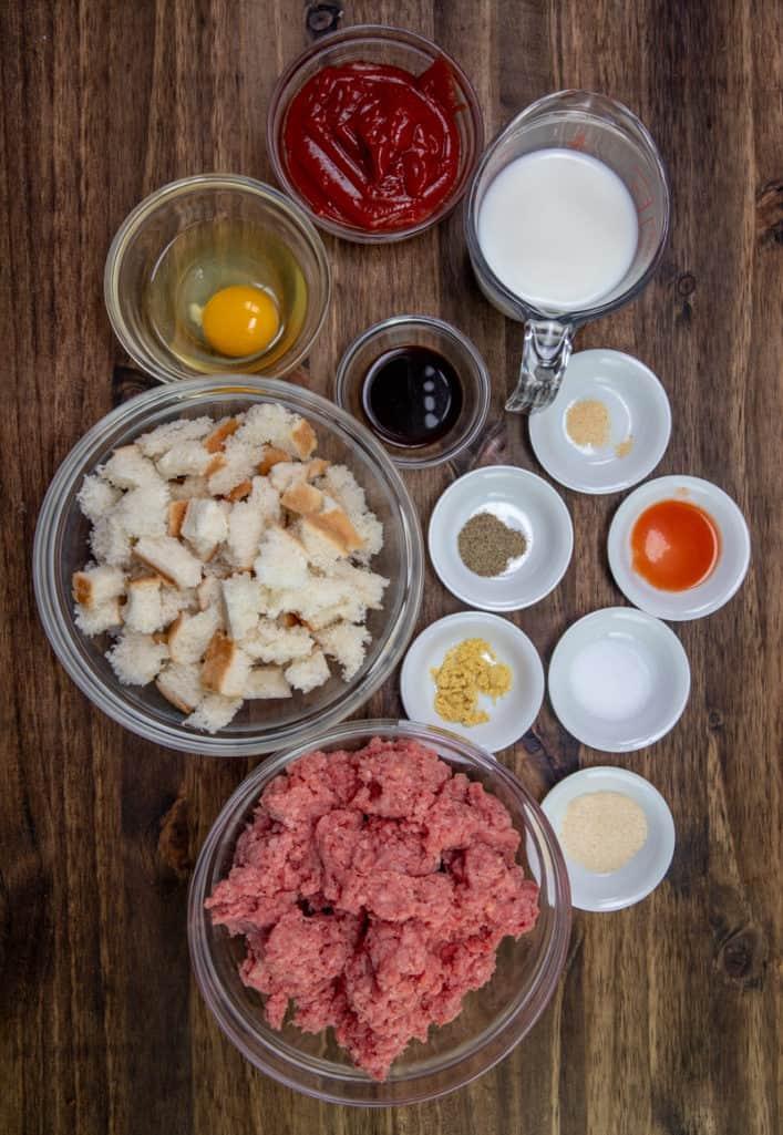 ground beef, milk, egg, sliced bread, Worcestershire sauce, onion powder salt, dry ground mustard, black pepper hot sauce, garlic powder, ketchup
