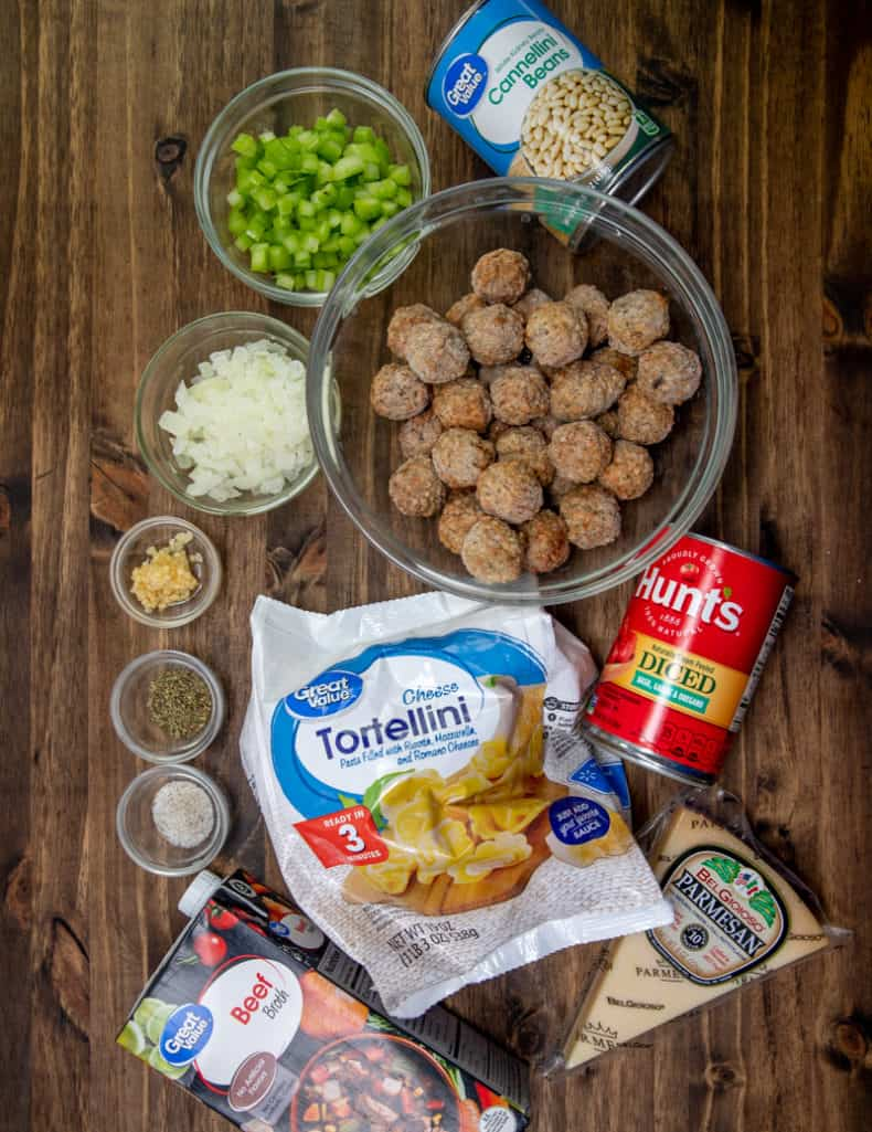 frozen Italian meatballs, frozen cheese tortellini, container beef broth, cannellini beans, Italian diced tomatoes (with basil, garlic and oregano), yellow onion, garlic, celery, Italian seasoning, salt and pepper, grated parmesan cheese