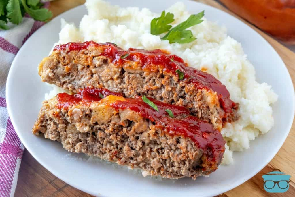 slices, meatloaf on a plate with mashed potatoes