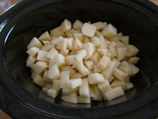 diced russet potatoes in a 6-quart oval slow cooker