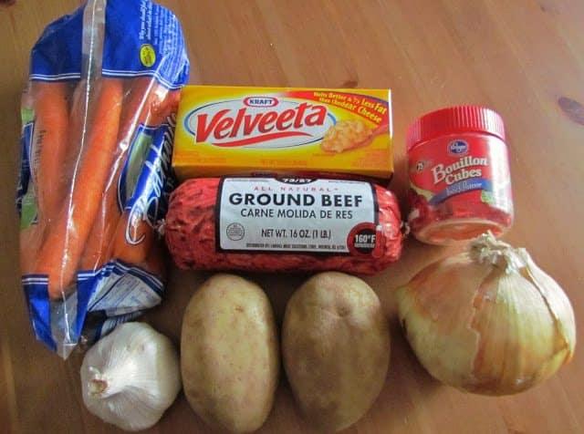 potatoes, onion, carrots, garlic, velveeta, beef bouillon, ground beef, milk