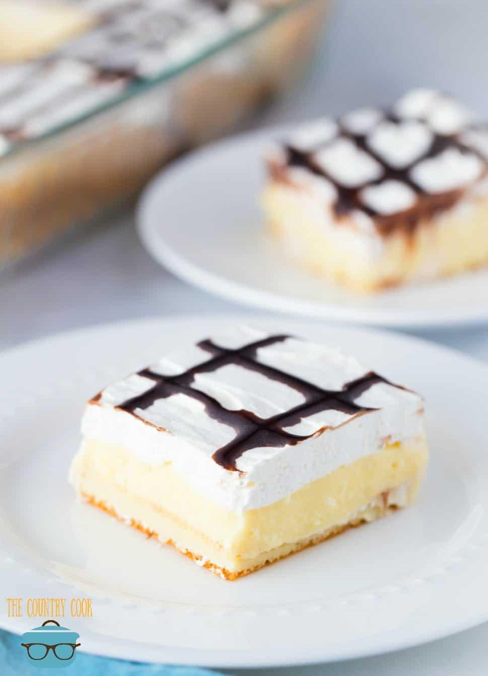 Easy Cream Puff Dessert, slices on round white plates.