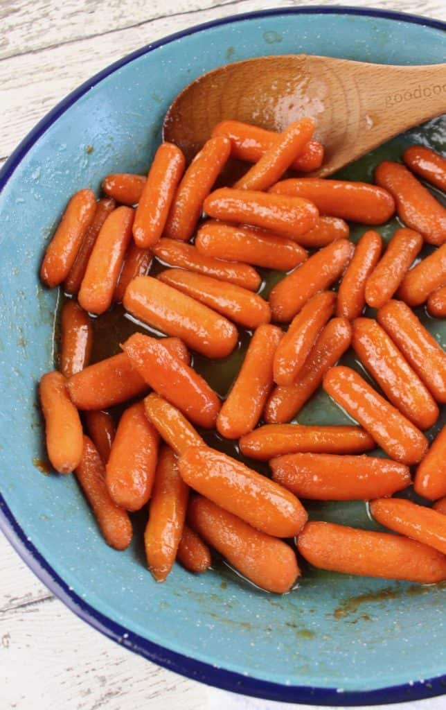 carrots simmering in maple glaze