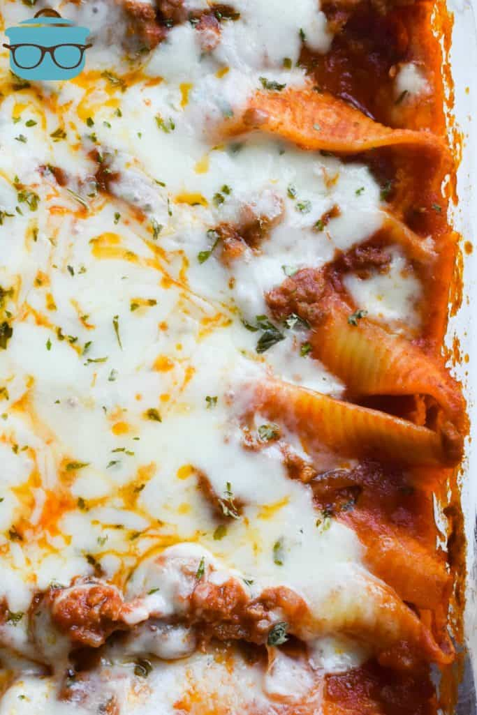 Stuffed Shells in a baking dish, fully baked with melted cheese