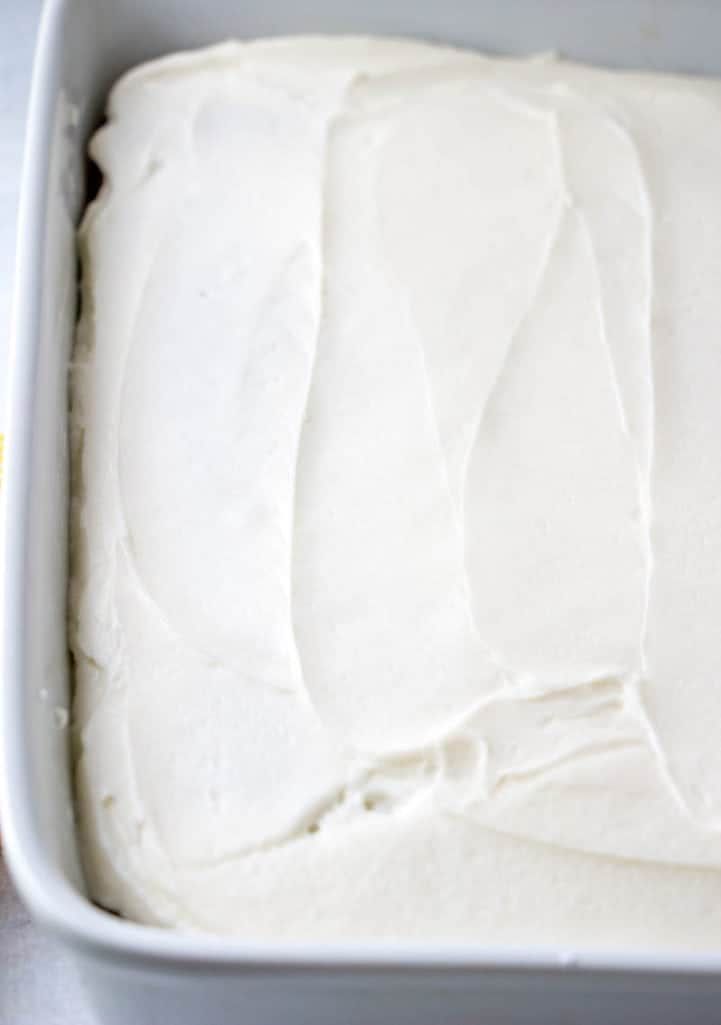 vanilla frosting spread on banana cake