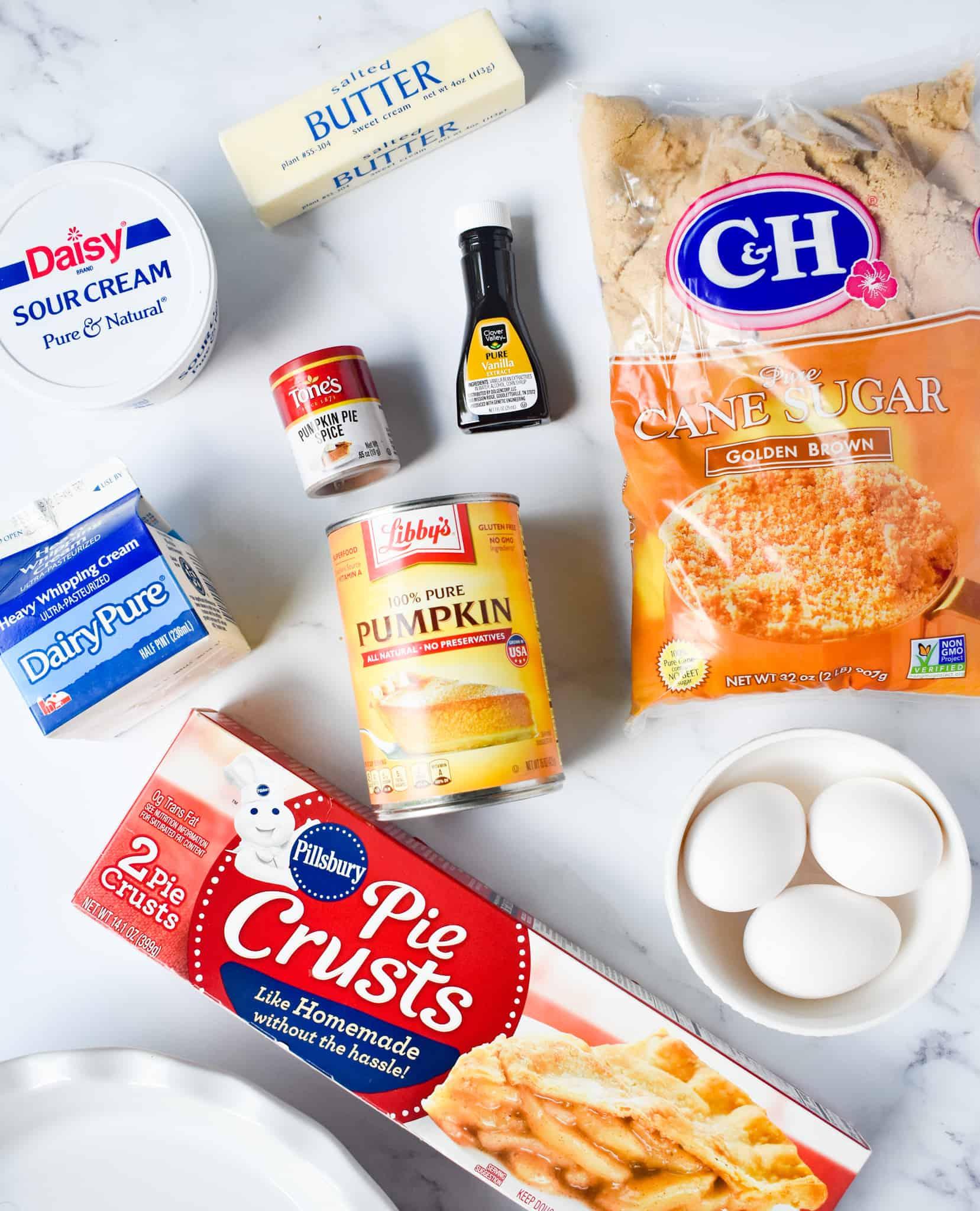 pie crust, canned pumpkin, heavy cream, sour cream, brown sugar, vanilla extract, eggs, butter.
