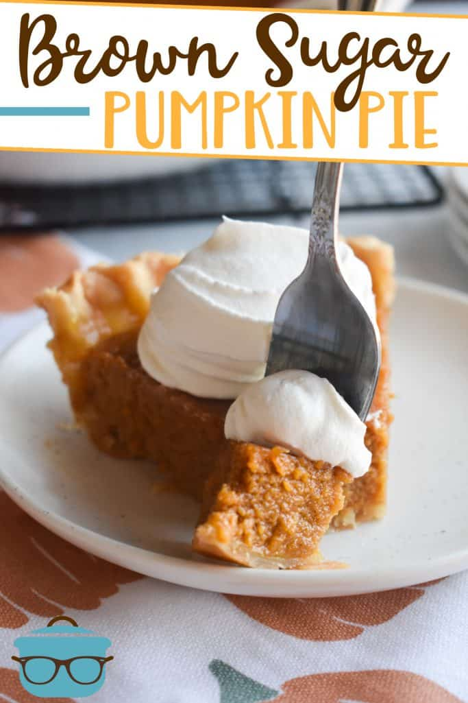 Brown Sugar Pumpkin Pie recipe from The Country Cook, slice on a plate with a fork scooping a bite
