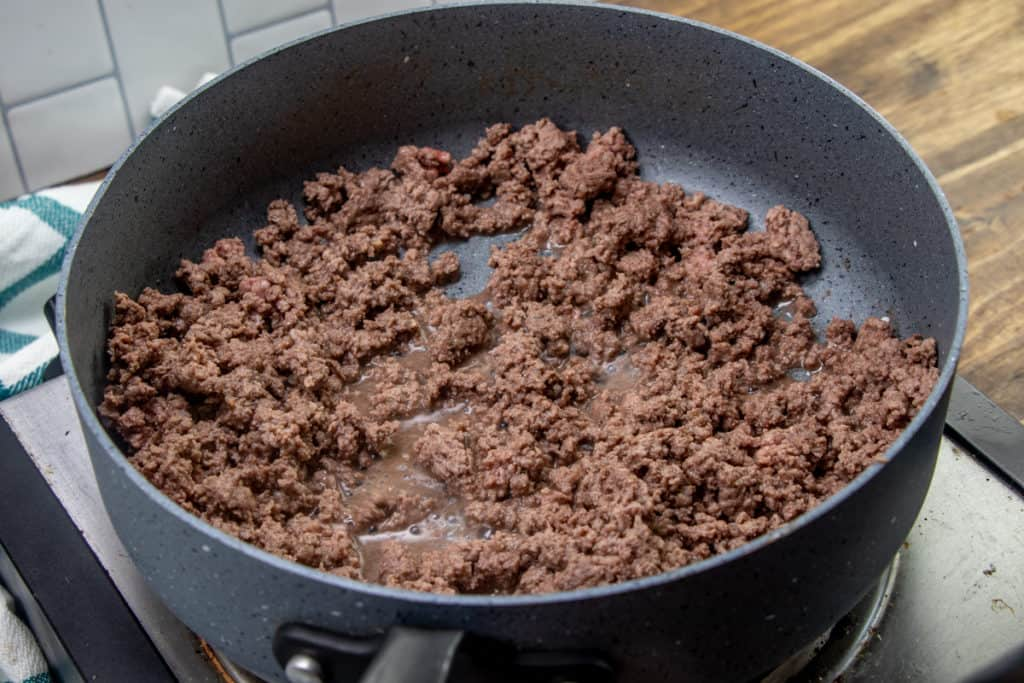 cooked and crumbled ground beef in a sauce pan