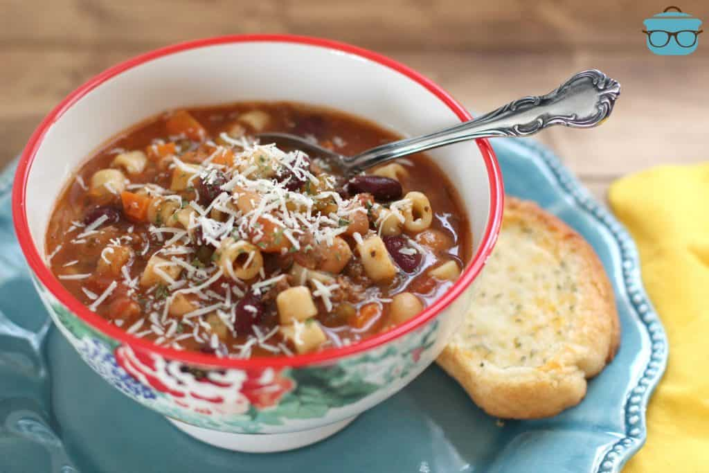 Crock Pot Pasta e Fagioli Soup in a bowl with Garlic Bread