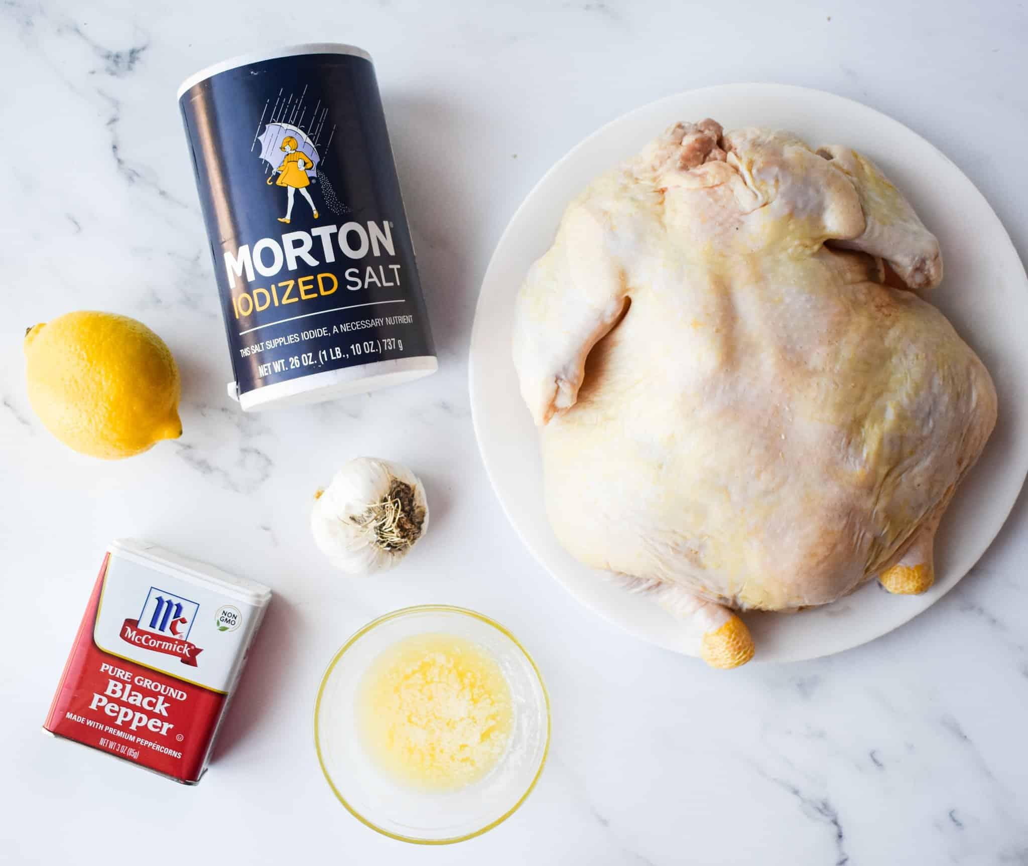 roasting chicken, salt and ground black pepper, lemon, garlic, good quality salted butter.
