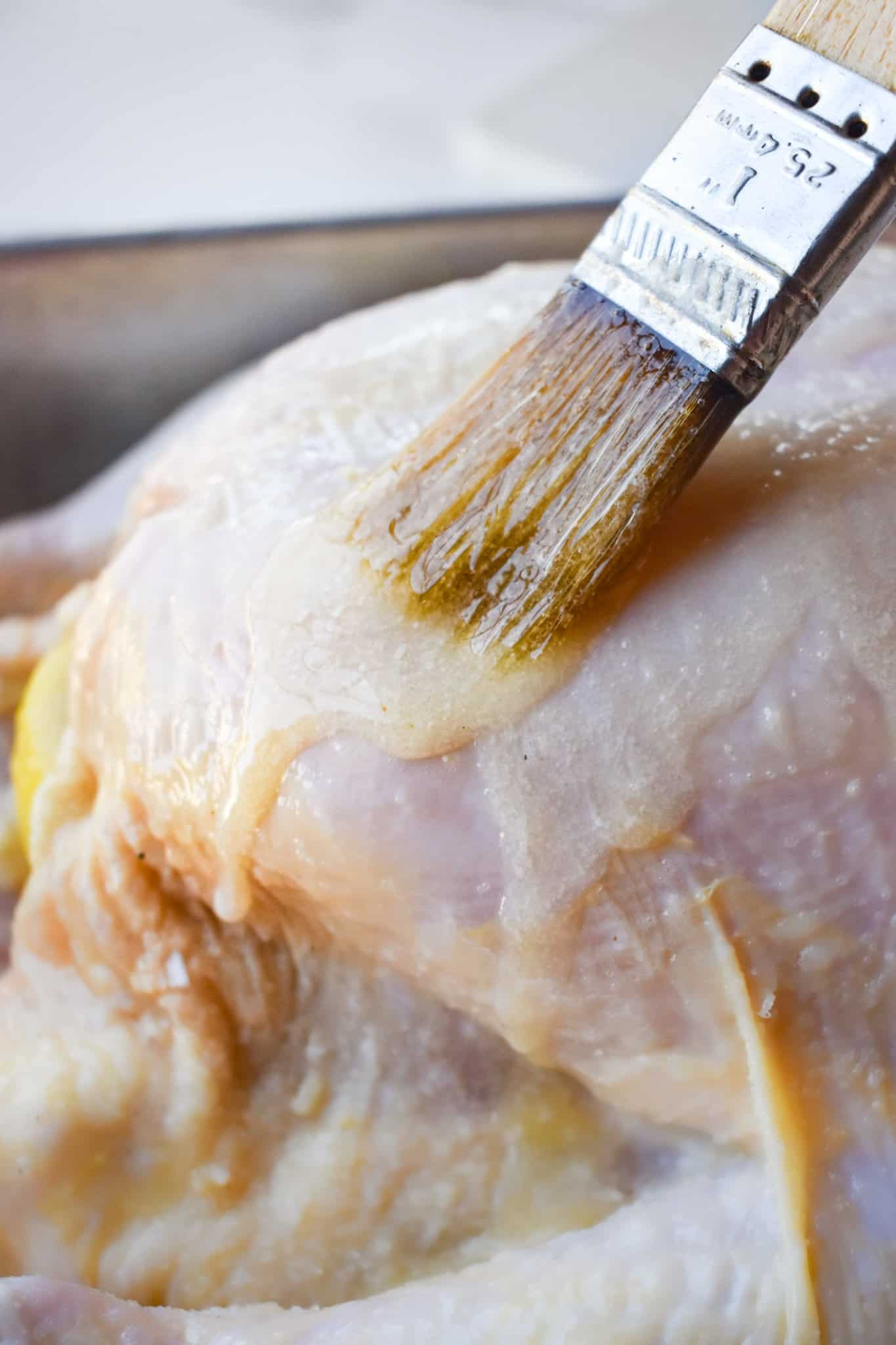 brushing chicken skin with melted butter.