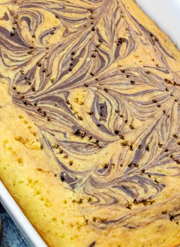 fudge marble cake with holes poked in it with a fork