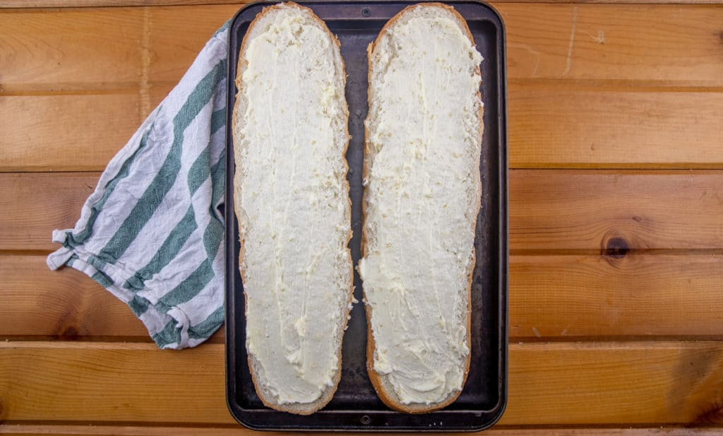garlic butter spread on both half of French bread loaf
