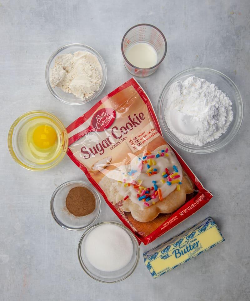 sugar cookie mix, butter or margarine, all-purpose flour, egg, granulated sugar, ground cinnamon, powdered sugar, milk.
