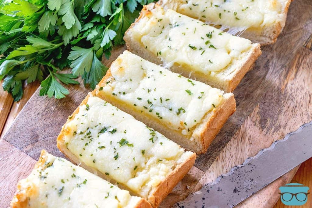 Garlic Cheese Bread, sliced on a cutting board