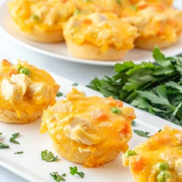 Chicken Biscuits Cups on a white tray topped with parsley flakes