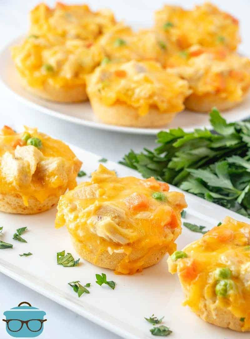 Chicken Biscuits Cups on a white tray topped with parsley flakes.