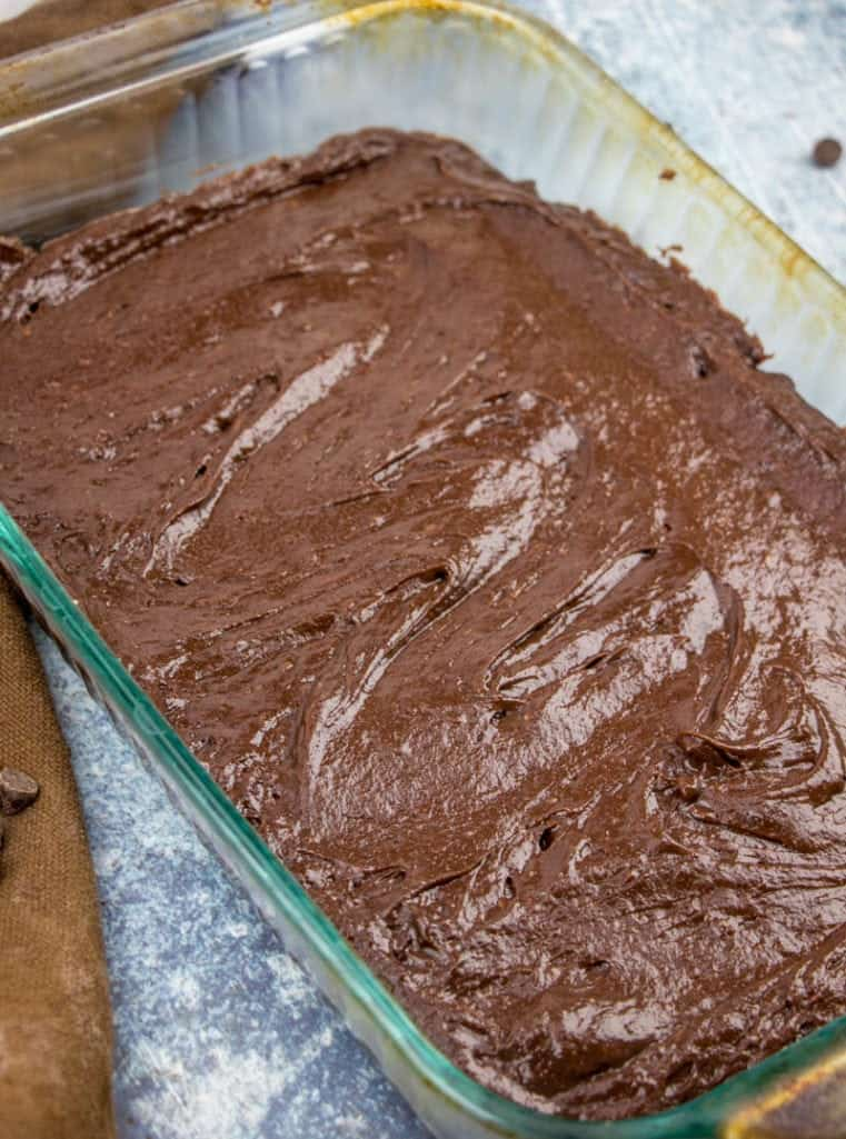 chocolate brownie cake mix batter poured into a 9x13 glass baking dish