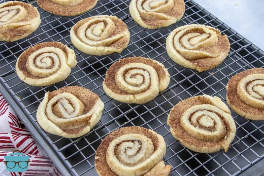 fully baked Cinnamon Roll-style cookies cooling on a baking rack